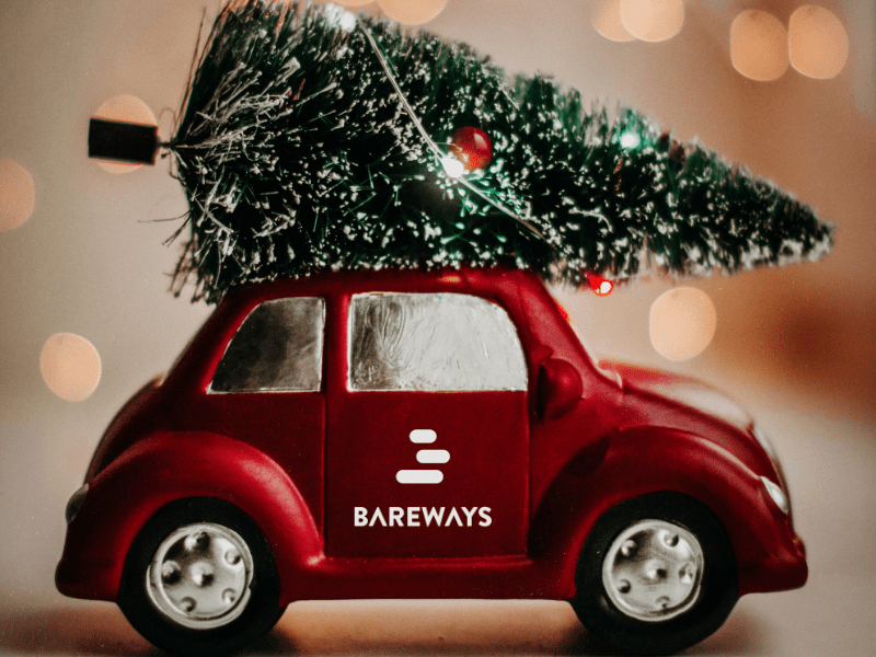 Best christmas songs. Red Beetle with a Christmas tree on the roof and the Bareways logo on the door.