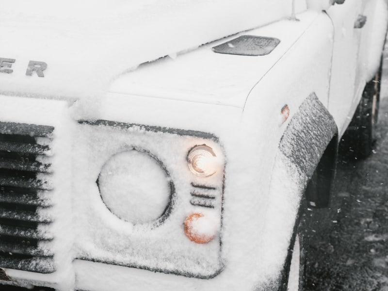 open frozen car doors. White frozen off-road vehicle.